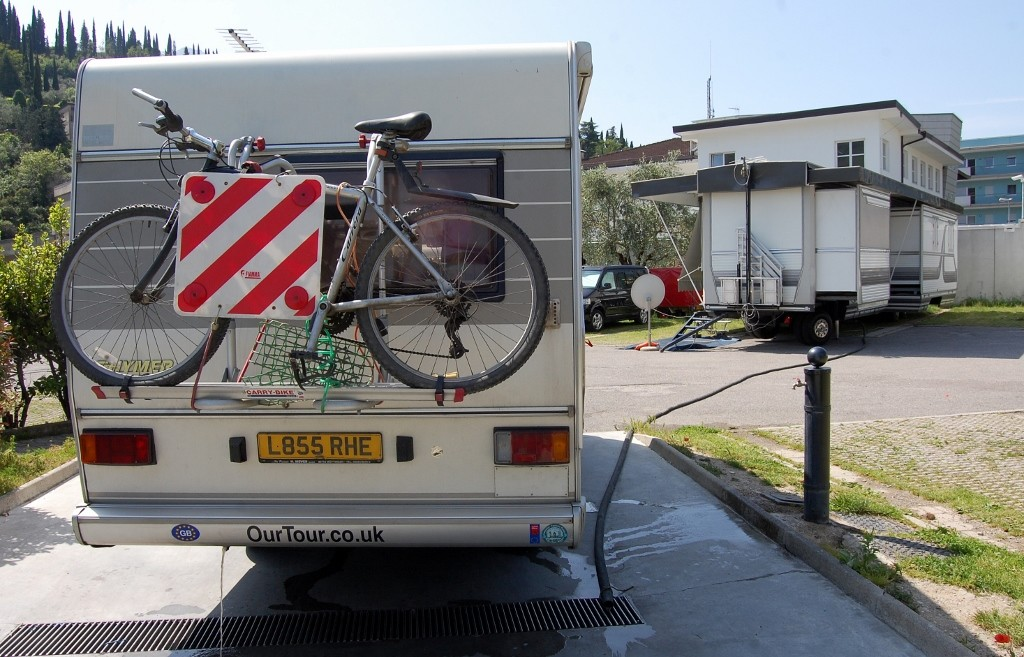Cheeky pipe going from big motorhome to waste water grate
