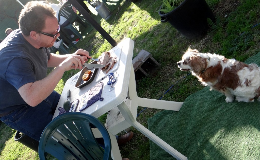 Charlie takes a serious interest in Jay's goose carving