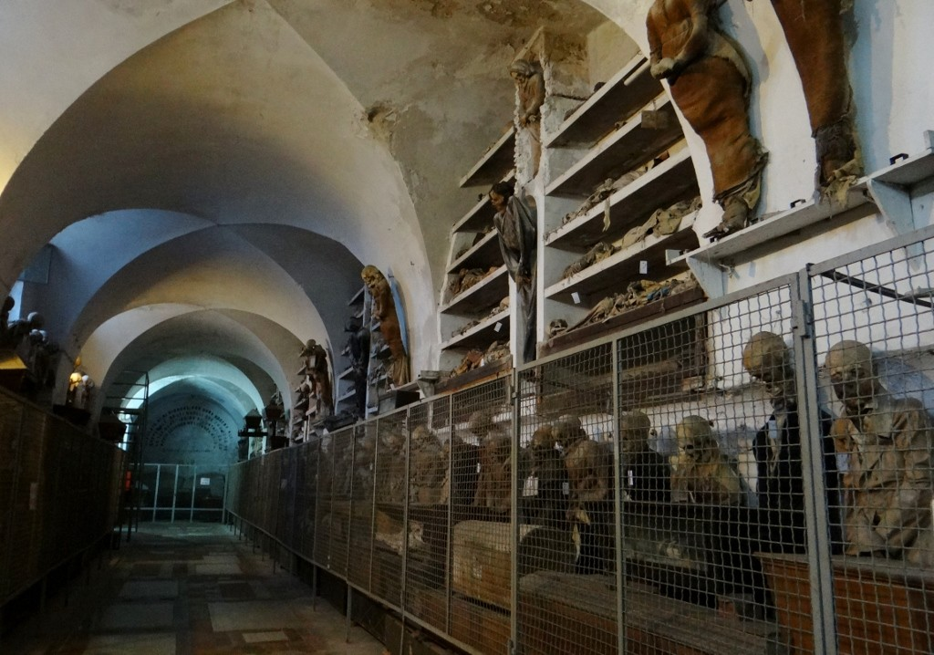 Catacombe Cappuccini the walls are lined with hanging up and lying down bodies