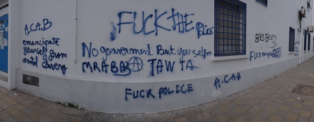 They say graffiti is a great way to judge to political temperature of a country. We've usually no idea what it means. This stuff in Bizerte takes no interpretation!
