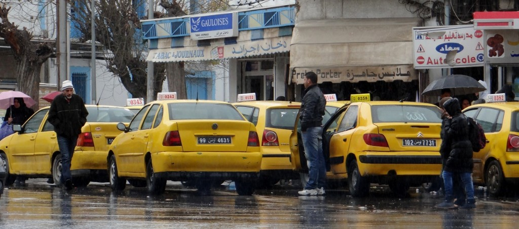 Pouring with rain but no one is getting a taxi.