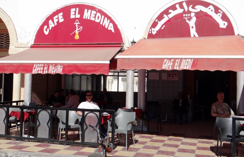Jay relaxes in the sun in the prime cafe in the medina