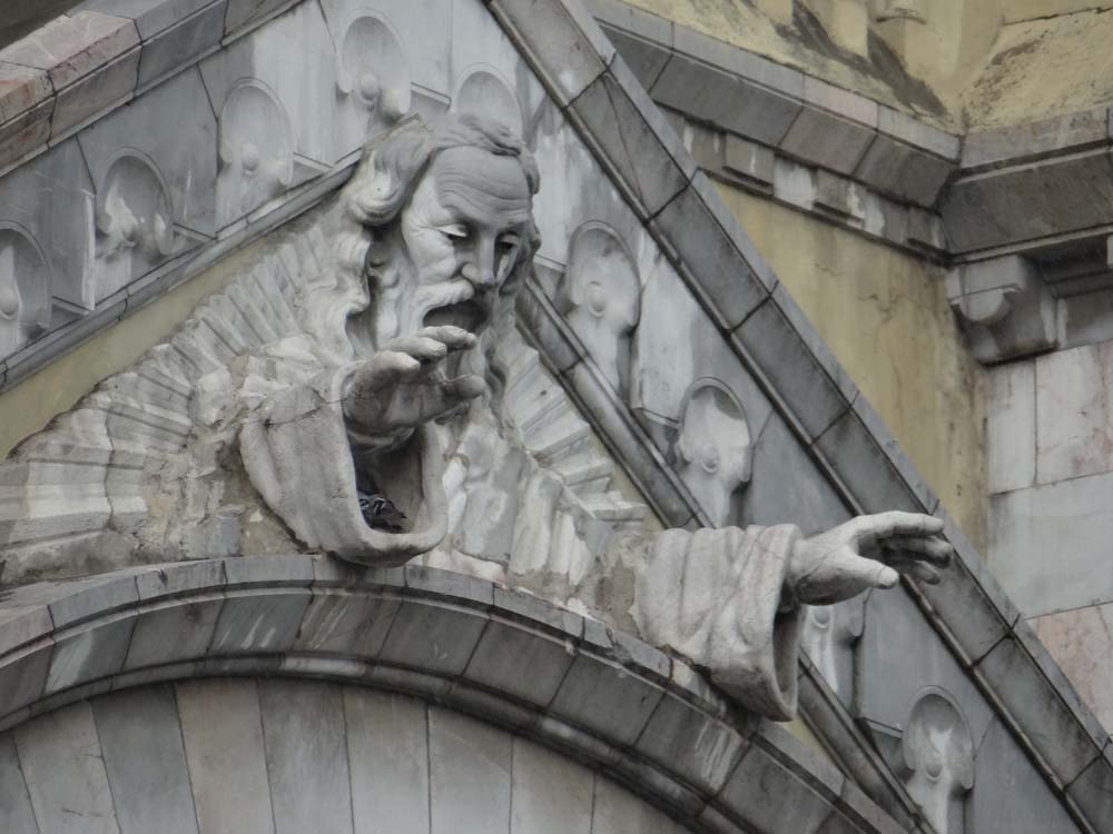 Unlikely-looking Jesus-Go figure leaping forth from a, ah, church on Ave Bourguiba. What the Blazes?