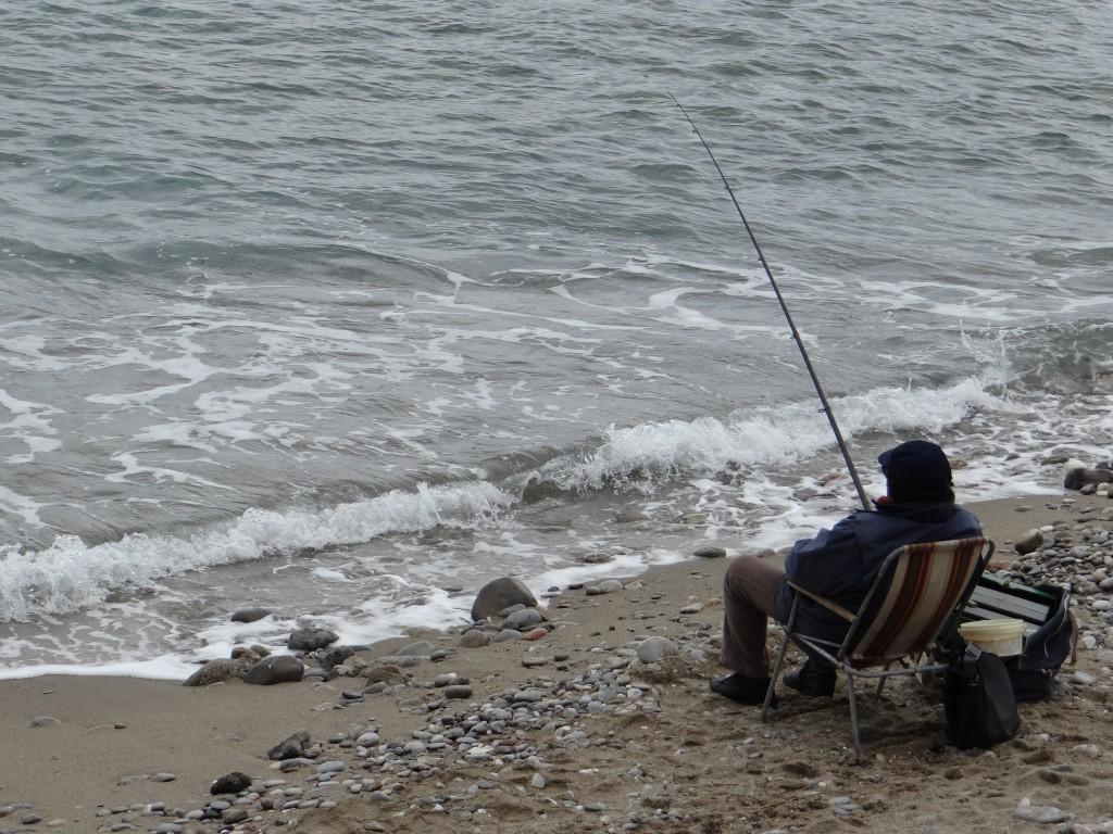 Sunday afternoon fishing on a Giardini-Naxos beach.
