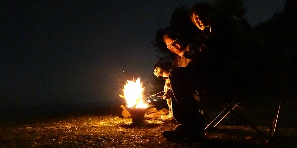 Toasting marshmallows on the beach in our fire pit