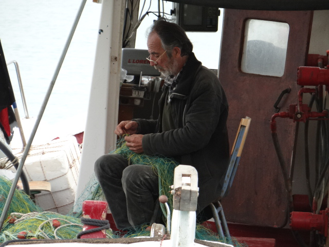 This chap sat on his still-floating boat and fixed nets, a job which looks like it requires not only dexterity, but the patience of an angel.