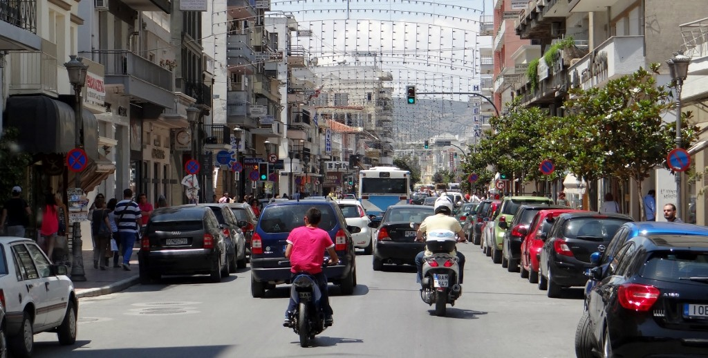 Busy Volos - the Christmas/Easter lights are still up - and on the right you can see the head of a chap about to ride his scooter right across the front of us!