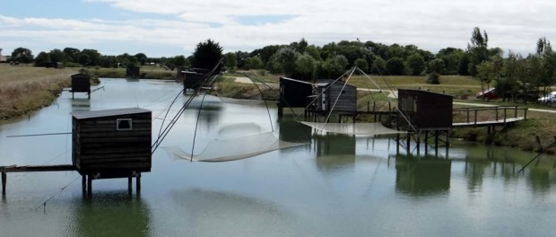 Lazy fishing; dip net, raise net, gather fish, it's a wonder there are any fish left in this inlet!