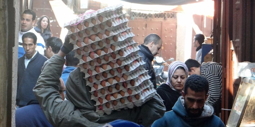 Eggs being carried, carefully, along a busy alley