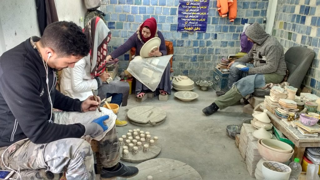 Pottery being painted by hand