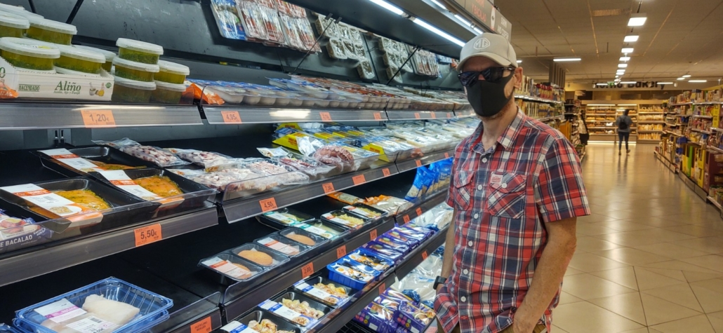 Masked up food shopping in Nerja, Spain